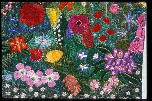 an embroidered section of the ribbon covered in bright flowers