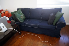loveseat(0.0), chair(0.0), floor(1.0), furniture(1.0), room(1.0), table(1.0), sofa bed(1.0), living room(1.0), couch(1.0), studio couch(1.0), hardwood(1.0),
