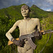 Suri Tribe Warrior With Body Paintings Posing With A Kalashnikov, Omo Valley, Ethiopia by Eric Lafforgue