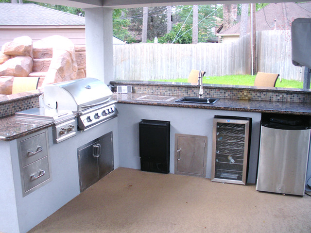 custom outdoor kitchen with granite countertops and tile