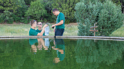 Jacob, Matthew, and Derek filter the nasty water from the water buffalo