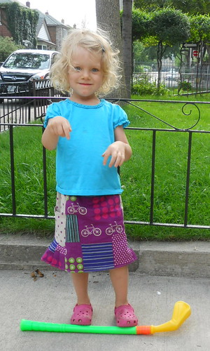 she's wearing a skirt! Yay!  This is the Oliver + S Music Class skirt from stashed Echino