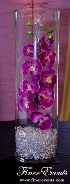 Purple Orchids In Cylinder Vase Stems Of Puple Orchids