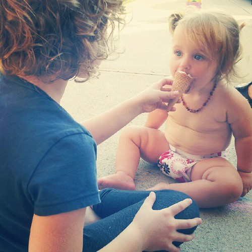 Baby's first ice cream cone. Best big sister ever.