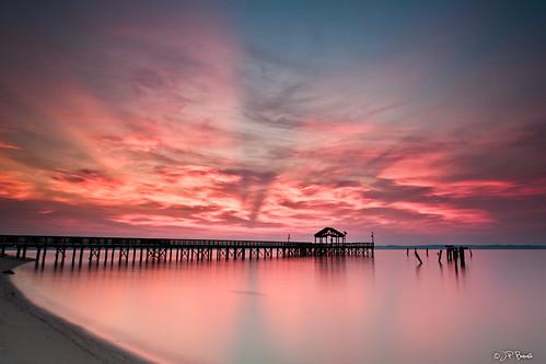 longexposure beach water clouds sunrise star virginia pier sand maryland shore pylons potomacriver surrender leesylvaniastatepark itsu2lyricsagain
