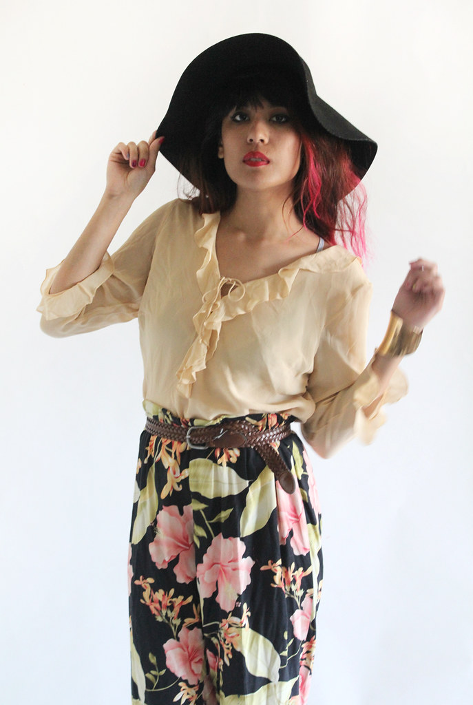 Vintage silk ruffled blouse and high waist floral pants by Tarte Vintage at shoptarte.com