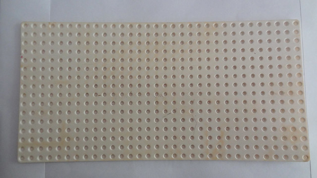 White Lego plate before the Hydrogen Peroxide bath