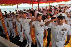 SIHANOUKVILLE, Cambodia (July 29, 2012) U.S., partner nation and Cambodian service members, along with representatives from non-governmental organizations stand at attention and render honors during the playing of the two nations' national anthems during the opening ceremony for Pacific Partnership 2012 in Cambodia .(U.S. Navy photo by Mass Communication Specialist 2nd Class Stephen Votaw)