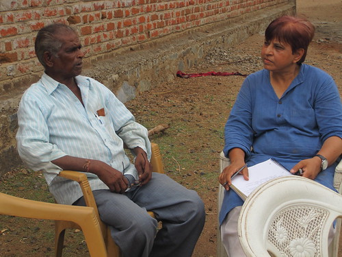 Kamjibhai Lalubhai (left) and Indira Pathak (right) at Kamjibhai's home.