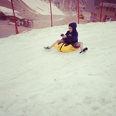 snowboarding(0.0), sand(0.0), winter sport(1.0), play(1.0), snow(1.0), sledding(1.0), sled(1.0),