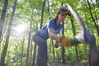 Julia Sievert '12 digs a shelf into the hillside to make hiking easier on the trail during maintenance work on Tuesday, Aug. 7.