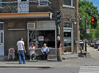 Men hang out in front of Greek bar in Park Extension neighborhood, Montreal