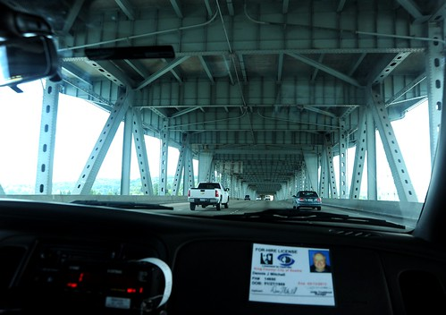 Under Hi 5, dashboard, taxi ride to the airport on the under carriage of the double decker freeway, taxi license, vehicles, bright day, beams, steel, Seattle, Washington, USA by Wonderlane