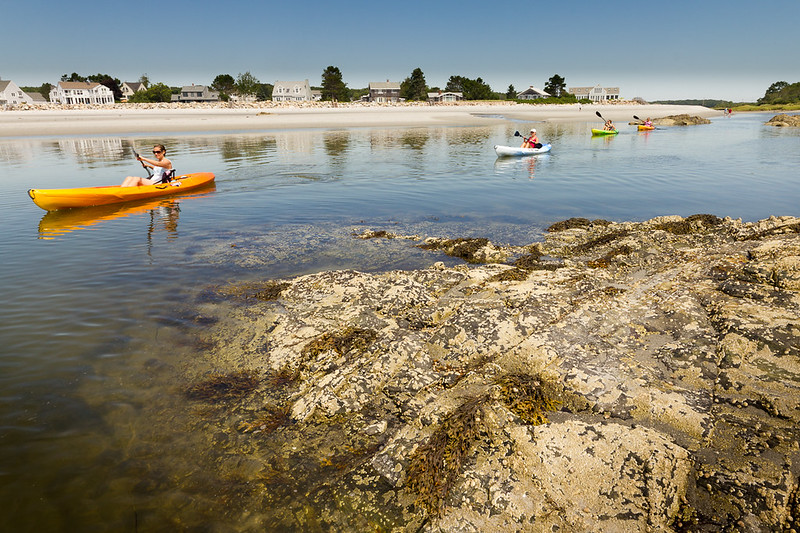 Kayaking off the shore of a New England beach