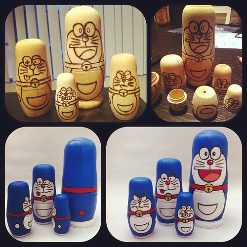 "My Doraemon nesting dolls for the @munkykingtoys ""Memories Are Made of This"" Show this Saturday.  Burned with soldering iron then painted. There's a special surprise inside the smallest one. :)"