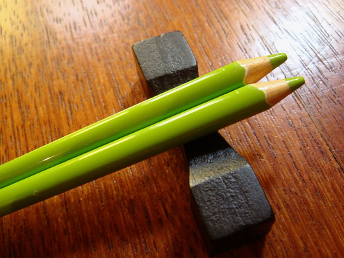 Chopsticks. Green crayons.