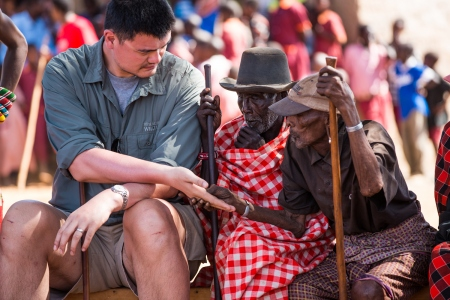 August 19th, 2012 - Yao Ming meets a village elder in an African village