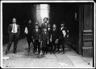 A group of Nashville newsies. In middle of group is 7 year old Sam. Smart and profane. He sells nights also. Nashville, Tenn, November 1910