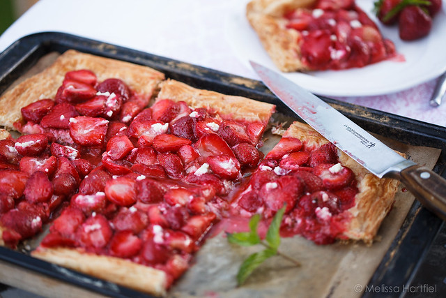 Strawberry tart with a slice cut out