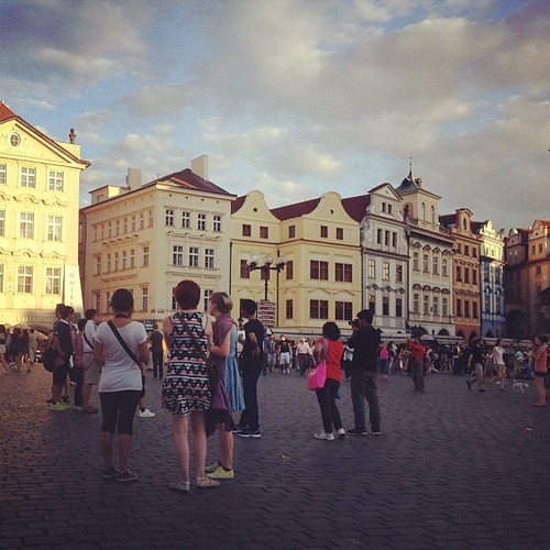 Extras standing around for a film shoot in the old town square of Prague