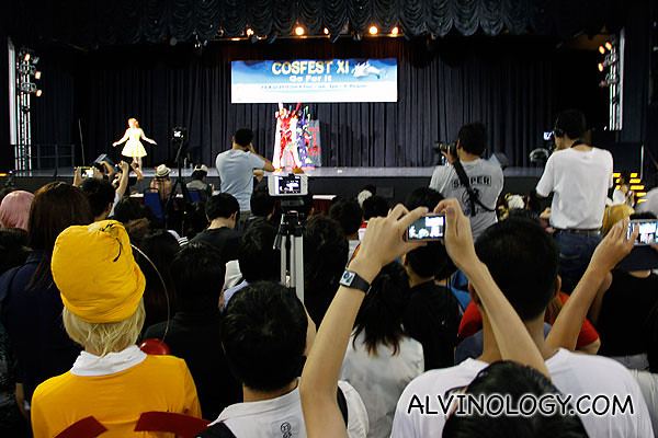Evangelion cosplayers on stage