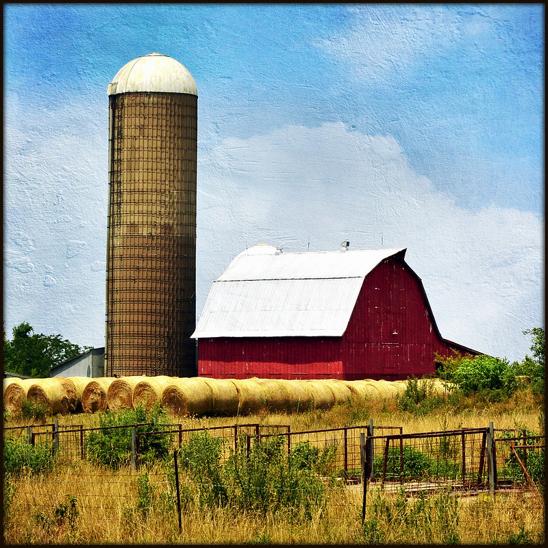 Red Barn with Silo, Bales, and Fences