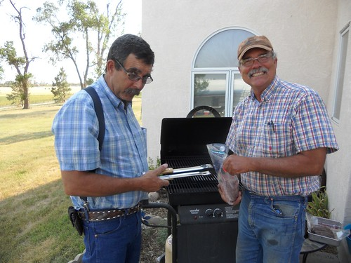 Dad and Carl grilling