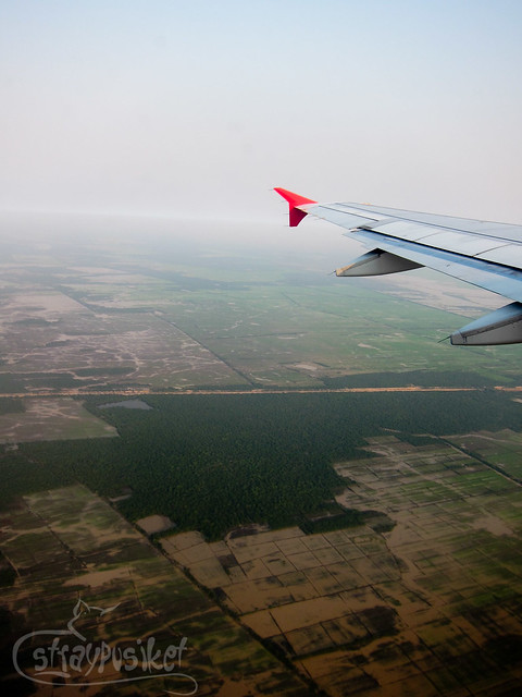 Air Asia flying above Siem Reap