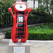 London 2012 mascot Wenlock takes the shape of an iconic red British telephone box by St Pauls Cathedral