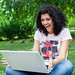 Girl Using Laptop in park by CollegeDegrees360