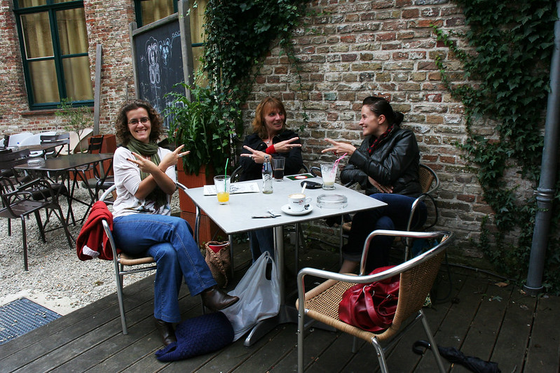 Gigi and friends hanging out at a coffee shop in Brugge