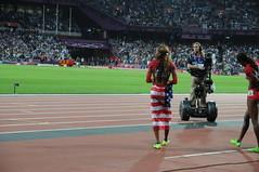 Equipe de relais américain du 4x400 aux JO Londres 2012. On voit, drappée du drapeau américain, Sanya Richards Ross