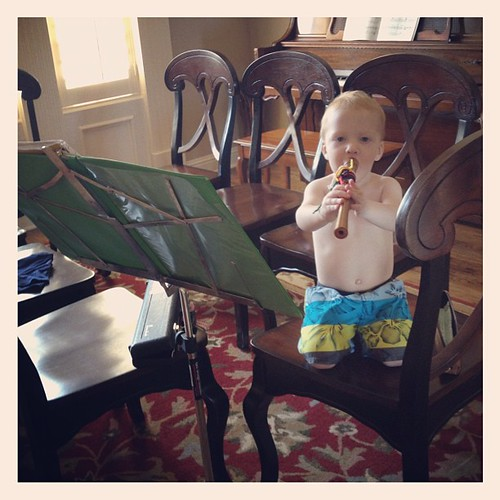 Owen, playing recorder, with Julianne's flute music, in a swimsuit (the only thing he wears now), in the dining room (that has no table)!  That's how we roll right now.