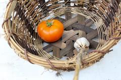 coconut(0.0), branch(0.0), christmas decoration(0.0), bird nest(0.0), twig(0.0), produce(1.0), food(1.0), basket(1.0),