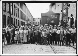 A part of the spinning force working in the Washington Cotton Mills. Group posed by overseer. All work, May 1911