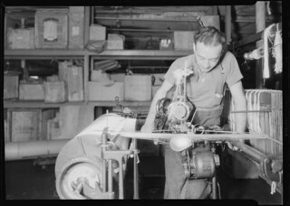 Textiles - Wishnack Silk Company - A machine twister is shown being operated, June 1937