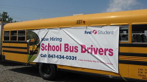 First Student school bus with job recruitment advertising banner.  Glenview Illinois. July 2012. by Eddie from Chicago