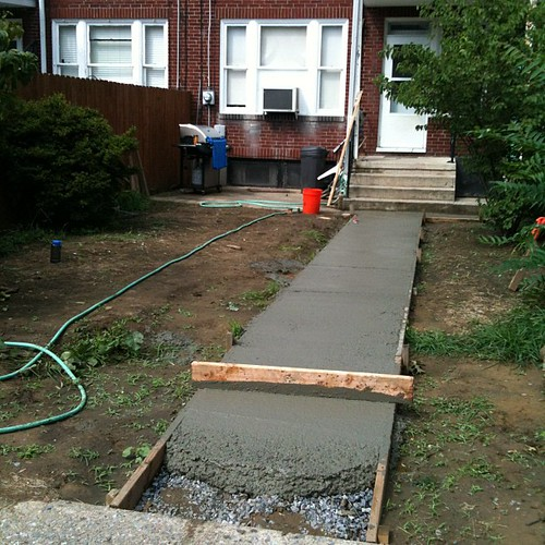Concrete sidewalk almost done.