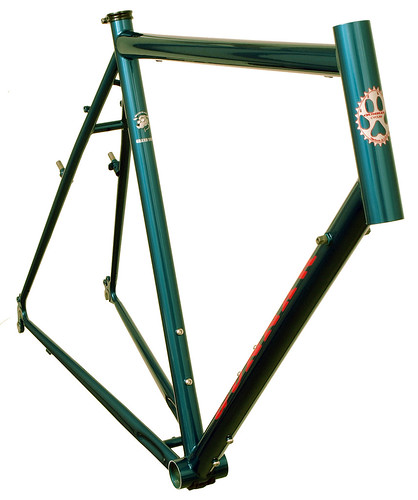 <p>The Grand Tour is Gunnar's classic and classy loaded touring design.  Though ready for long distance unsupported touring, it's quite functional for commuting and century riding, as well.  Here's a front view of the Gunnar Grand Tour painted Teal with red decals.</p>