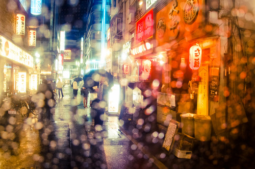Tokyo life through a transparent 500 Yen umbrella