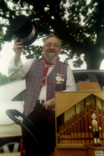 cheerful barrel organist by pho-Tony