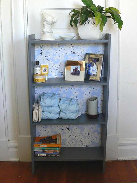 Jenny: Bookshelves Makeover with Wrapping Paper and Mod Podge!