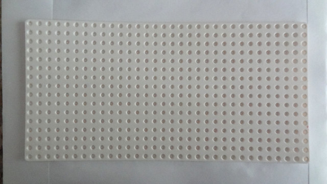 White Lego plate AFTER the Hydrogen Peroxide bath
