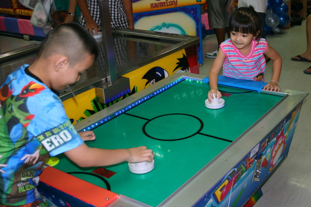 Ja and Pae Playing Air Hockey