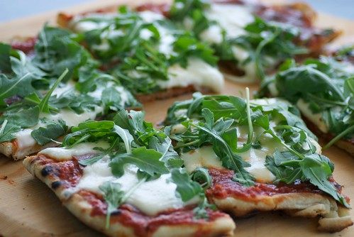 grilled salami, mozzarella and arugula pizza