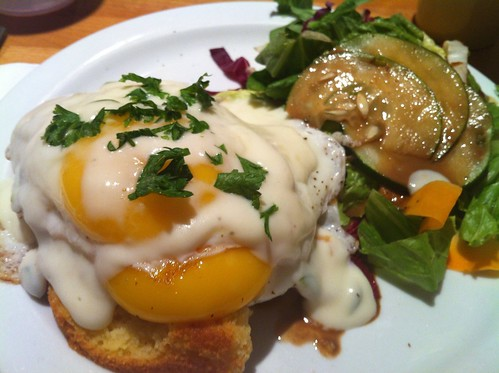 sunny side up eggs over cornbread with jalapeno cheddar sauce