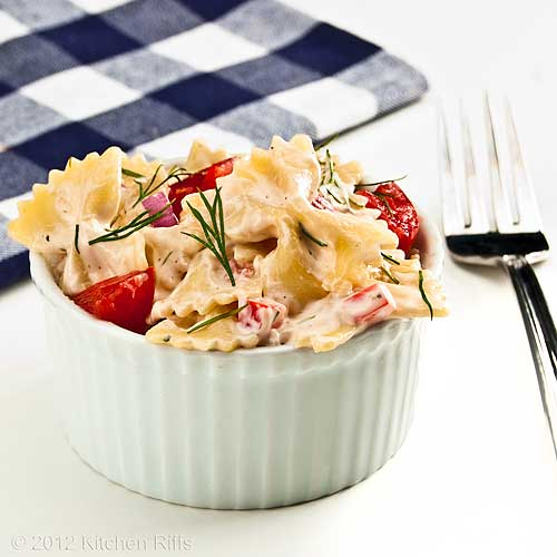 Pasta Salad with Dill Garnish in White Ramekin
