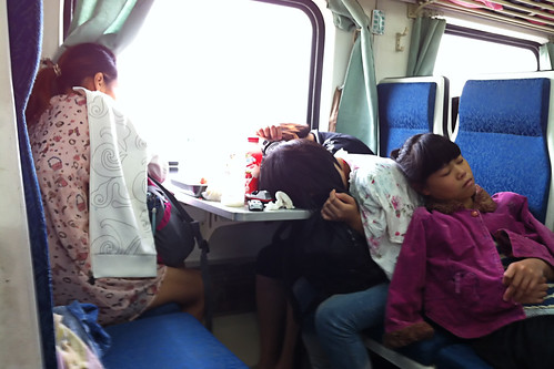 Chinese people sleeping in the train