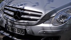 wheel(0.0), rim(0.0), mercedes-benz m-class(0.0), grille(0.0), mercedes-benz e-class(0.0), automobile(1.0), automotive exterior(1.0), vehicle(1.0), automotive design(1.0), mercedes-benz(1.0), mercedes-benz r-class(1.0), bumper(1.0), land vehicle(1.0), luxury vehicle(1.0), vehicle registration plate(1.0),
