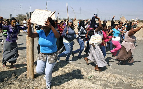 Women demonstrating at the location of the killing of 34 South African platinum mineworkers by police on August 16, 2012. President Zuma has established a commission of inquiry. by Pan-African News Wire File Photos